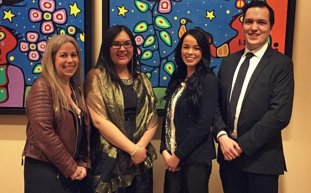 New members of the Indigenous Affairs team in front of a painting.
