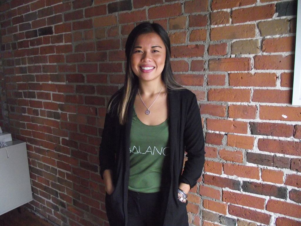 Kim Kirton standing wearing a shirt with the Balance logo on it.