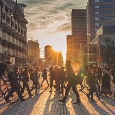 Students walking through a crosswalk.