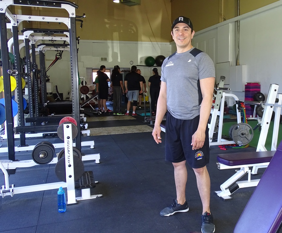 Trevor Monaghan standing in a gym