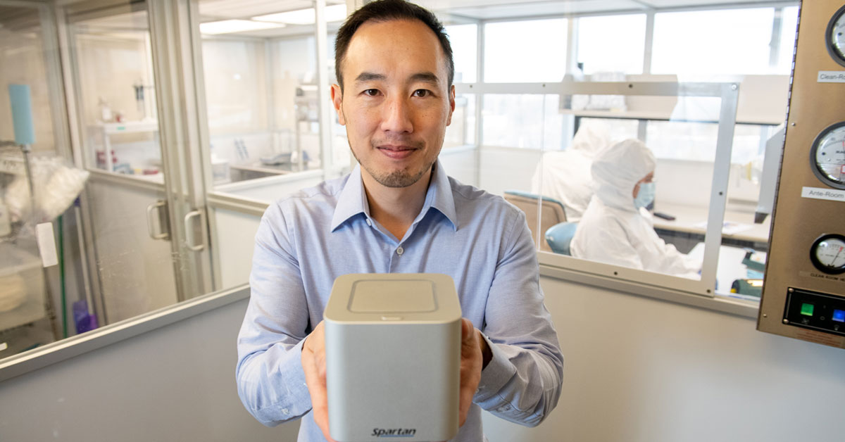 uOttawa alumnus Paul Lem holds up his invention, the Spartan Cube