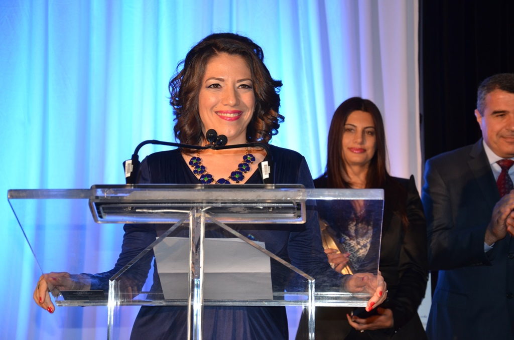 Pascale Fournier recieving the Award for Excellence from the Canada Arab Business Council in 2014.