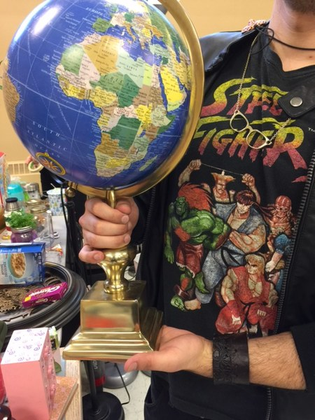 A student holding a globe of the world.
