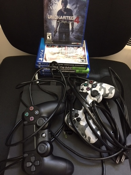 PlayStation controllers, games and wires.