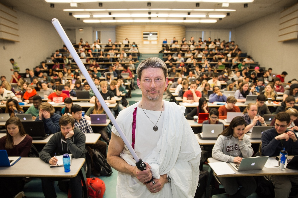 Richard Burgess in costume, holding a light sabre