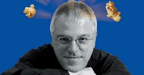 Une photo de Robert Fontaine, du maïs soufflé jaillit de sa tête.
