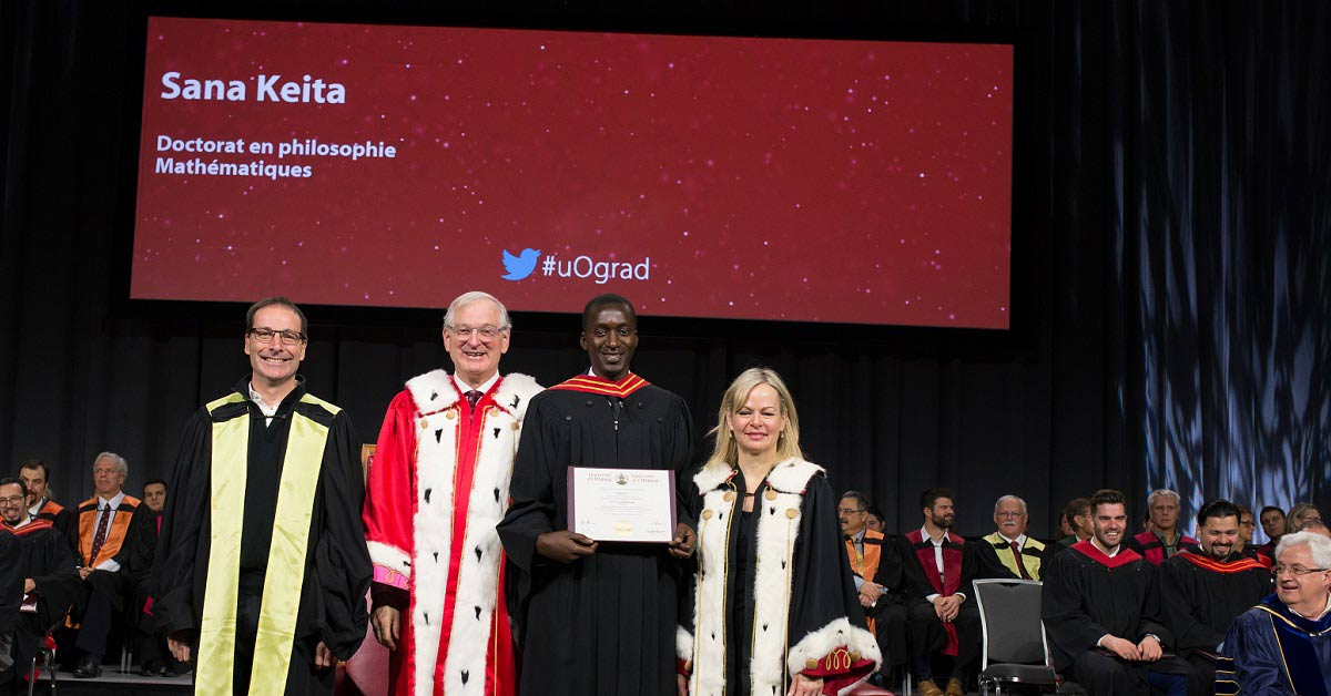 Sana Keita with uOttawa dignitaries on stage at fall 2018 Convocation.