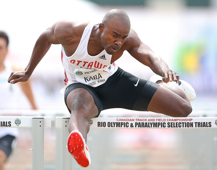 Sekou Kaba jumps a hurdle with arms outstretched