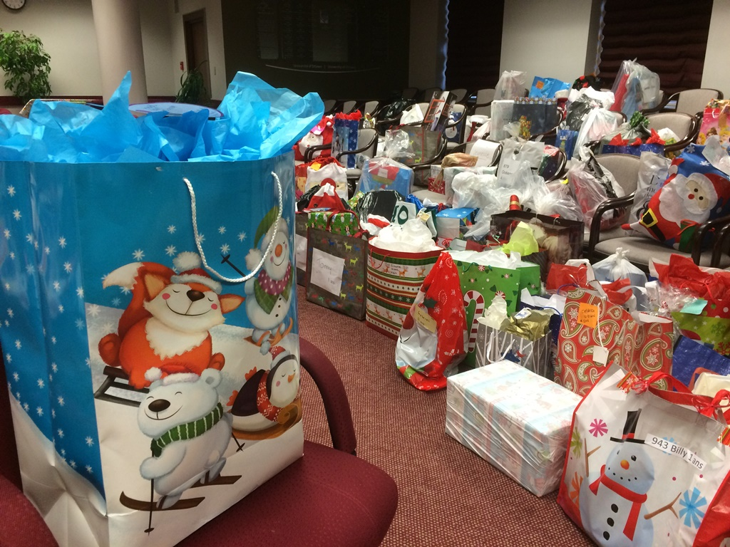 Hundreds of gifts piled up on chairs