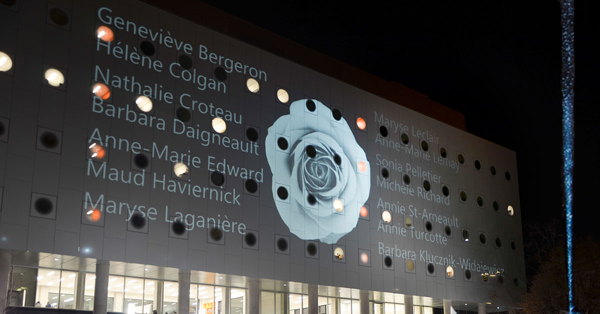 Exterior shot of uOttawa's STEM Complex with the victims' names projected on the facade.