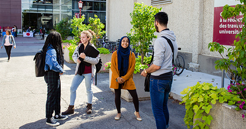 Students talking outside on campus