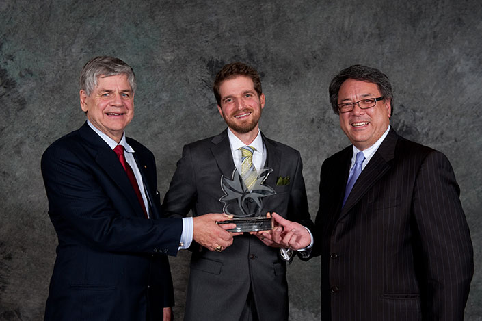 Jesse Cooke receiving the Youth Tourism Entrepreneur Award (with Yukon MP Larry Bagnall and Parks Canada CEO Daniel Watson)