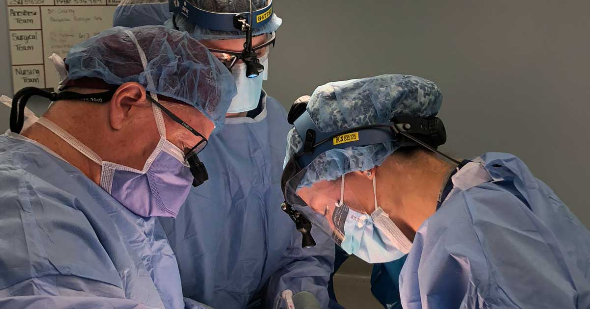 Three physicians from The Ottawa Hospital conducting a medical procedure