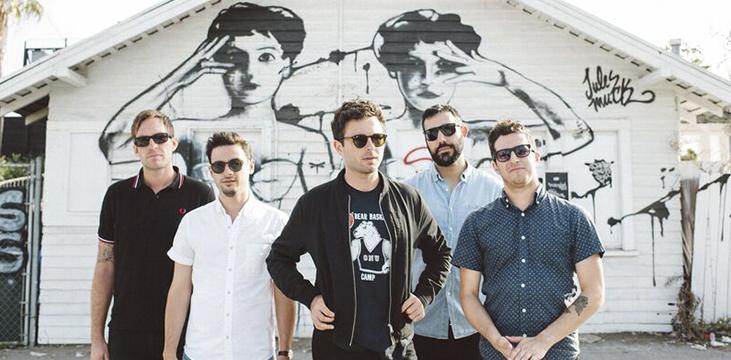 Five men wearing sunglasses