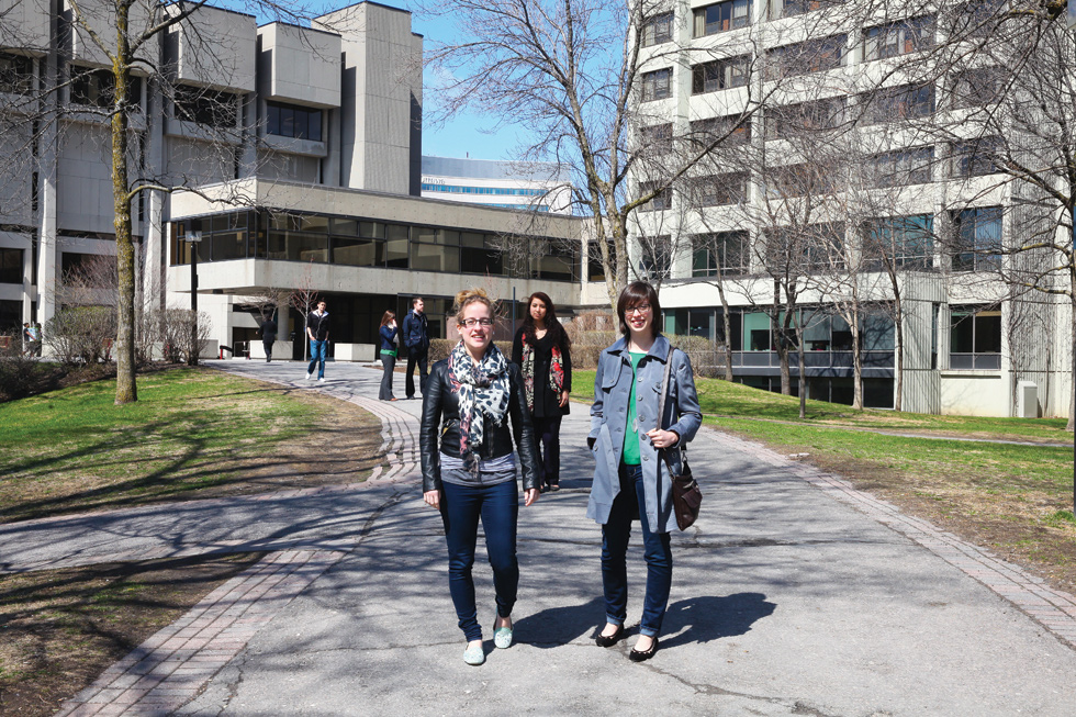 Two female students walking on campus in 2013.