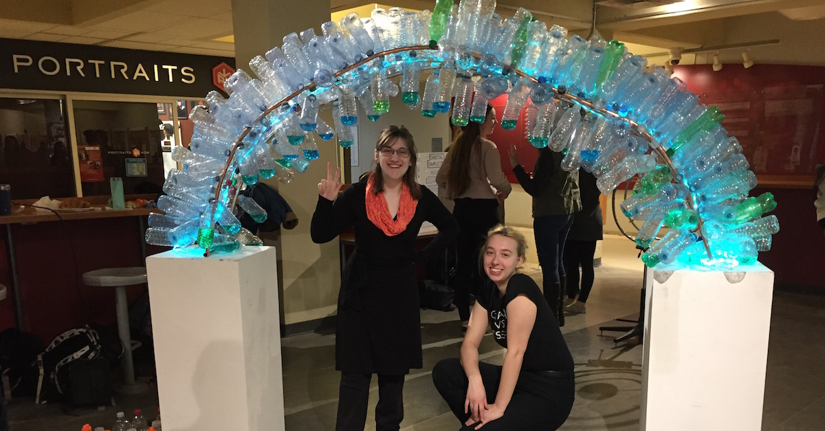 Victoria Rodgers and Emily Janek with their sculpture made from recycled water bottles.