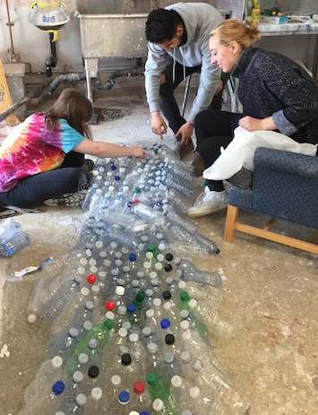 Victoria Rodgers, Ziad Salameh and Emily Janek with their sculpture made from recycled water bottles.