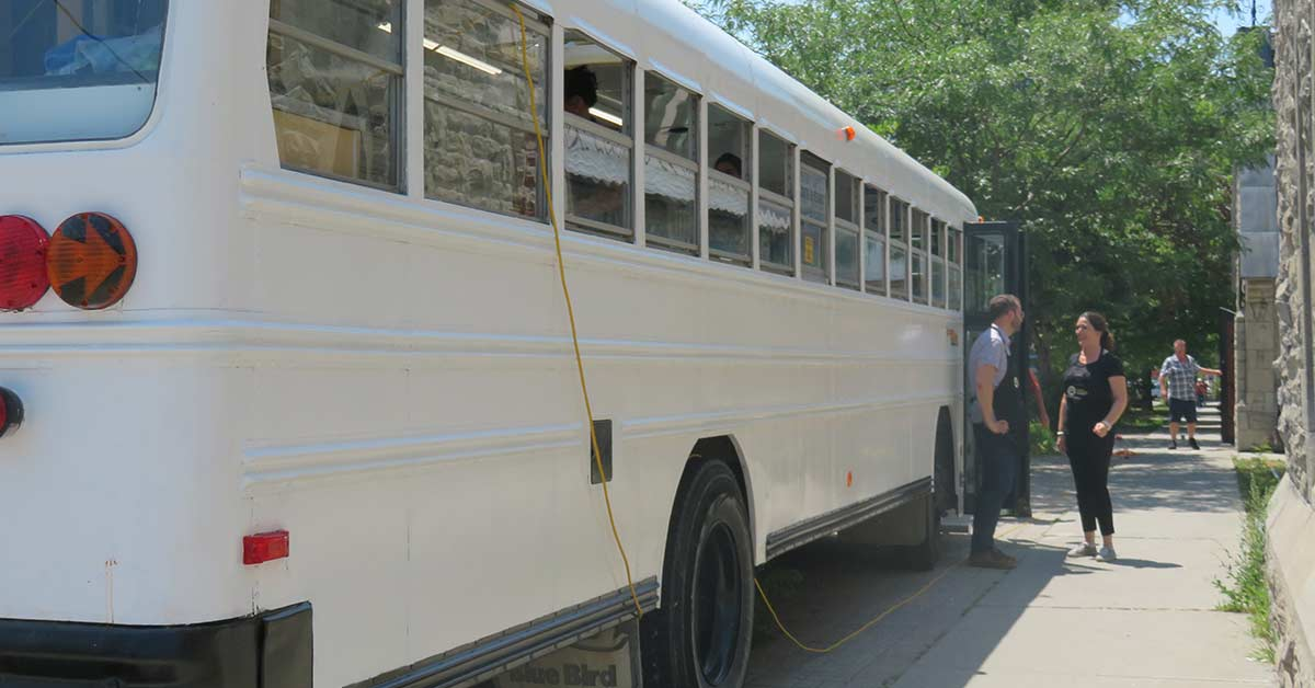 Bus seen from the back, with yellow extension cord.