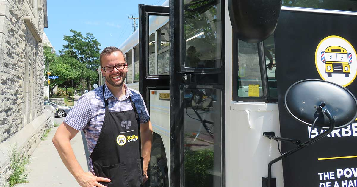 François Thibeault standing by the bus door.