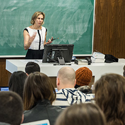 Teacher holding a class to students.