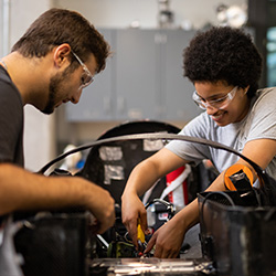 Two students working on a engineering project.