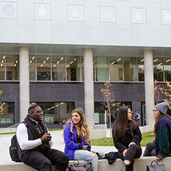 Students discussing on campus.