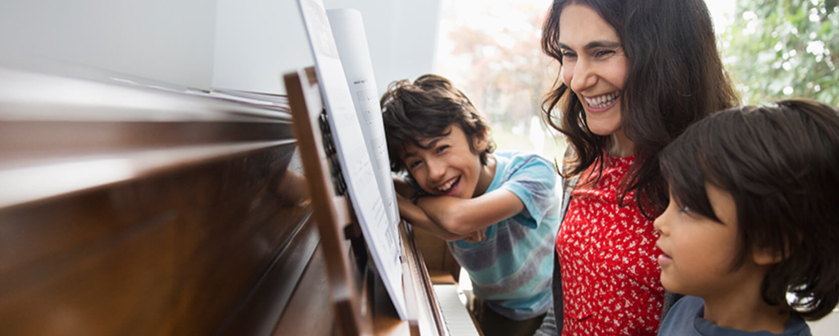 Canada Life picture - Family playing piano