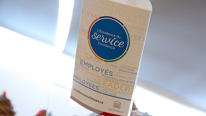 Image of a tent card with the Service Excellence