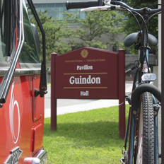 Bike and OC Transpo bus are parked in front of Roger Guindon Hall