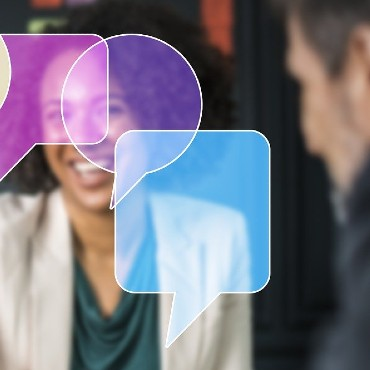 Speech bubbles with people in the background