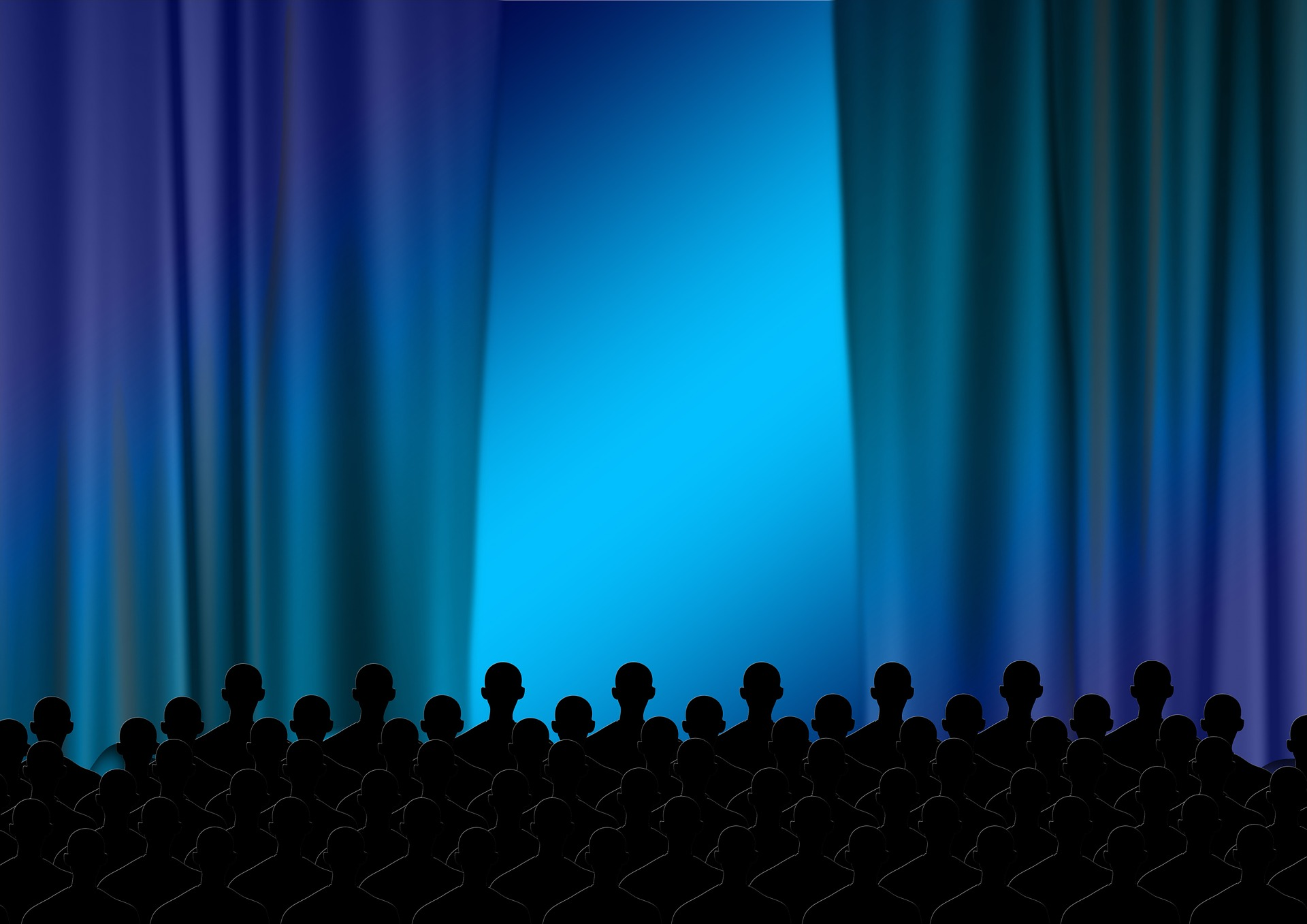 People standing up in front of a theater's curtains