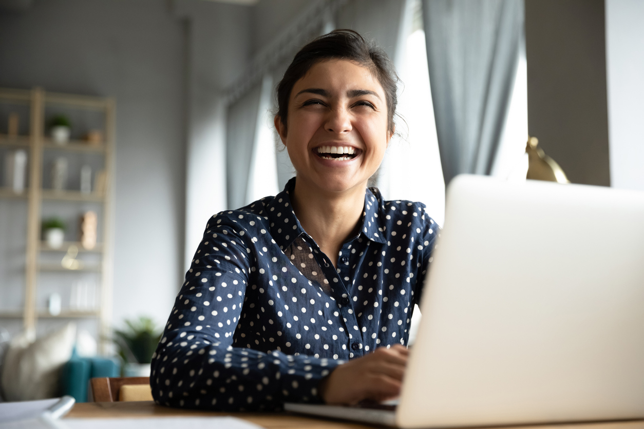 Smiling woman in front of her computer