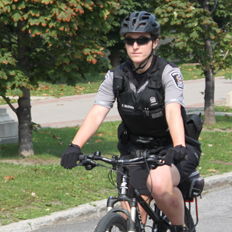 Picture of a Protection Services' security guard riding their patrol bike