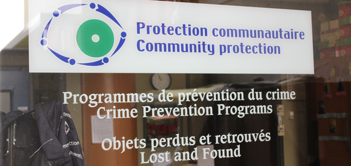 Community Protection's office through outside window, showing their sign