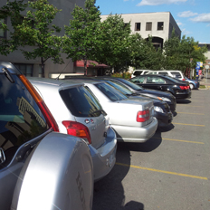 Photograph of parking Lot K full of parked cars