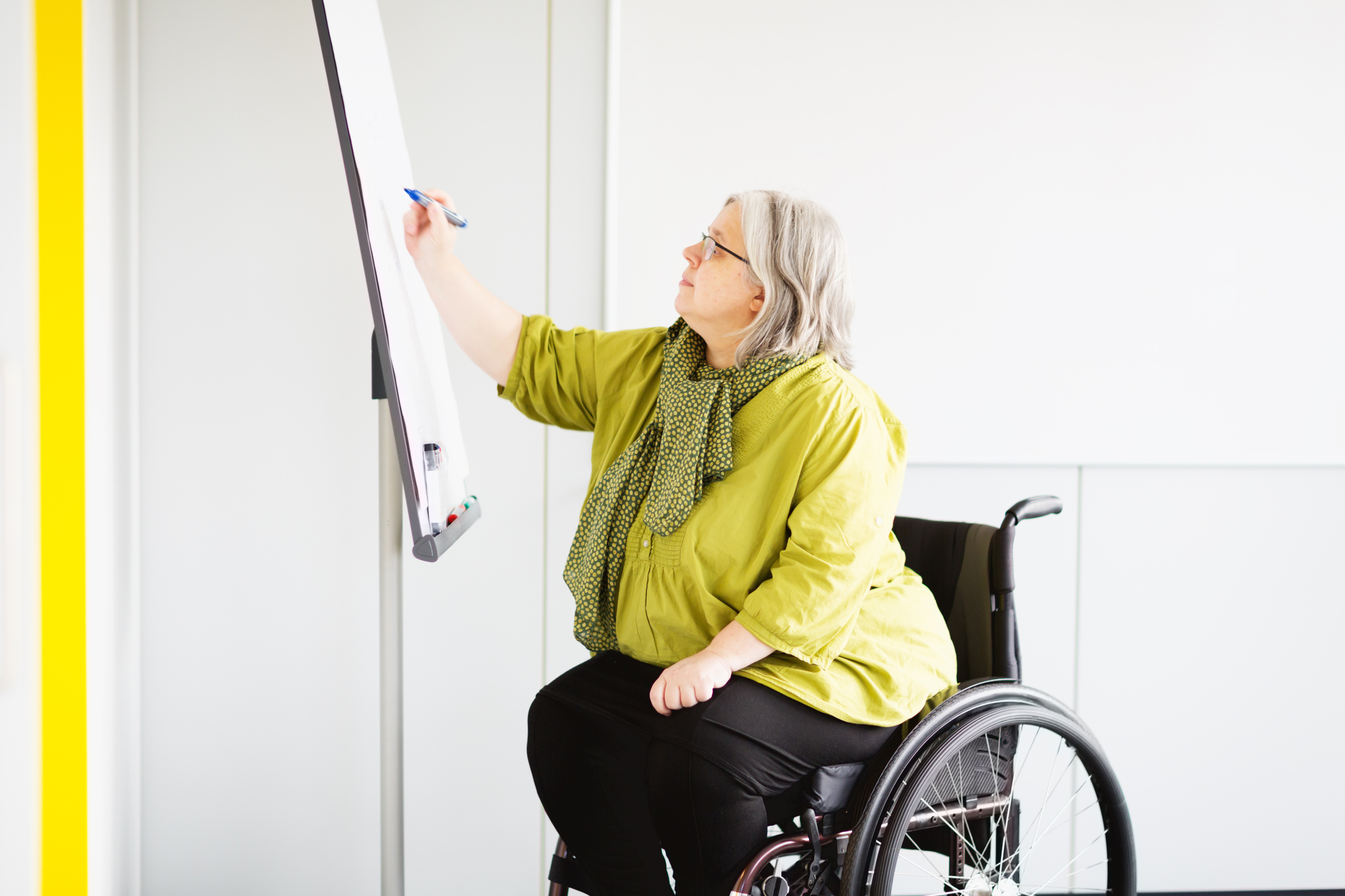 woman-in-wheelchair-working-in-office