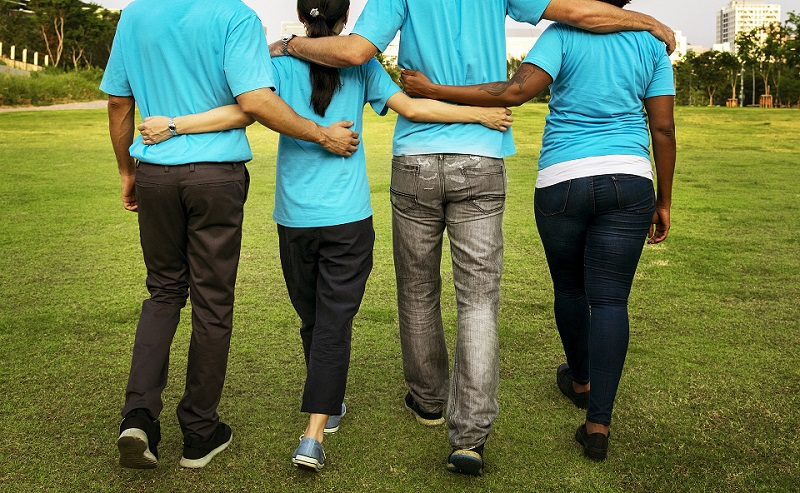 group of people arms around the waist