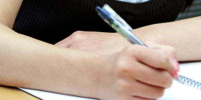 Hand taking notes