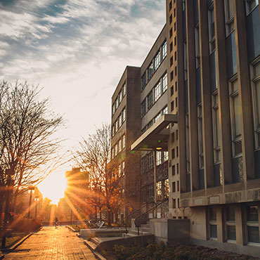 Bright sunrise on the walkway of the Vanier building.