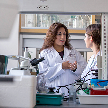 Dr Nafissa Ismail talking with a student in her lab.