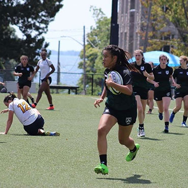 Rugby athletes on the field.