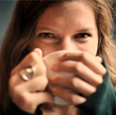 Female student drinking coffee.