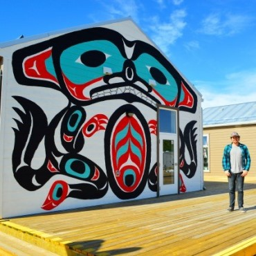 Student in the Yukon in front of an inuit mural.