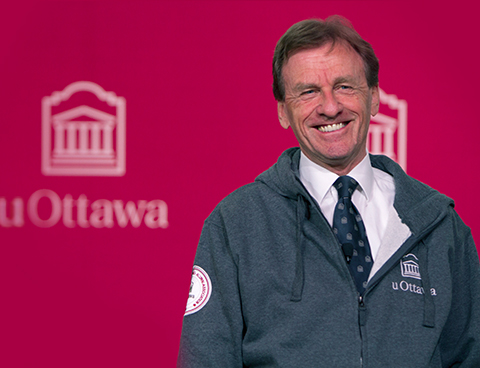 Allan Rock, smiling, with the uOttawa logo in the background.