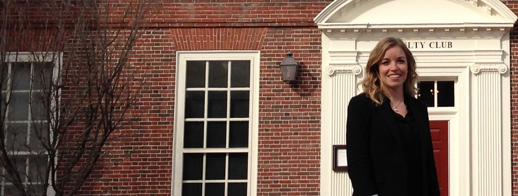 Megan Cotnam-Kappel stands outside the red brick façade of a building at the Harvard Graduate School of Education.