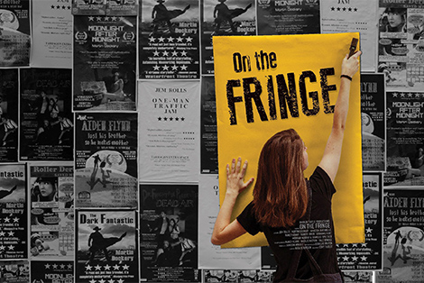 "Young woman staples a poster reading ""On the Fringe"" to a wall festooned with many smaller leaflets advertising Fringe Festival shows."