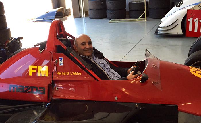 Raj Narula sits in a racecar
