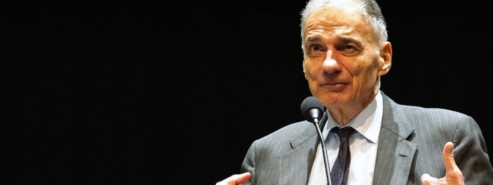 Ralph Nader speaks at a microphone