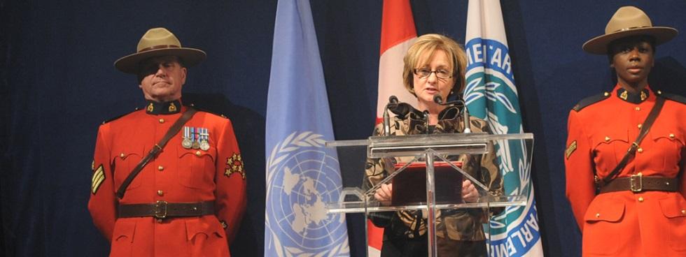 Elizabeth Rody at a podium.