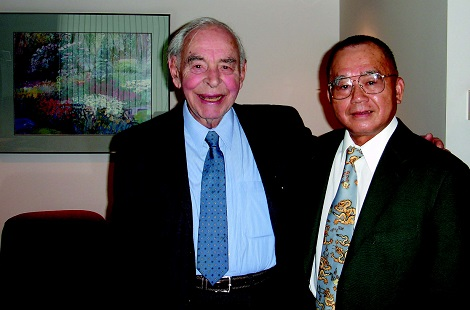 Hans Baer with his arm around the shoulders of Ruey Yu.